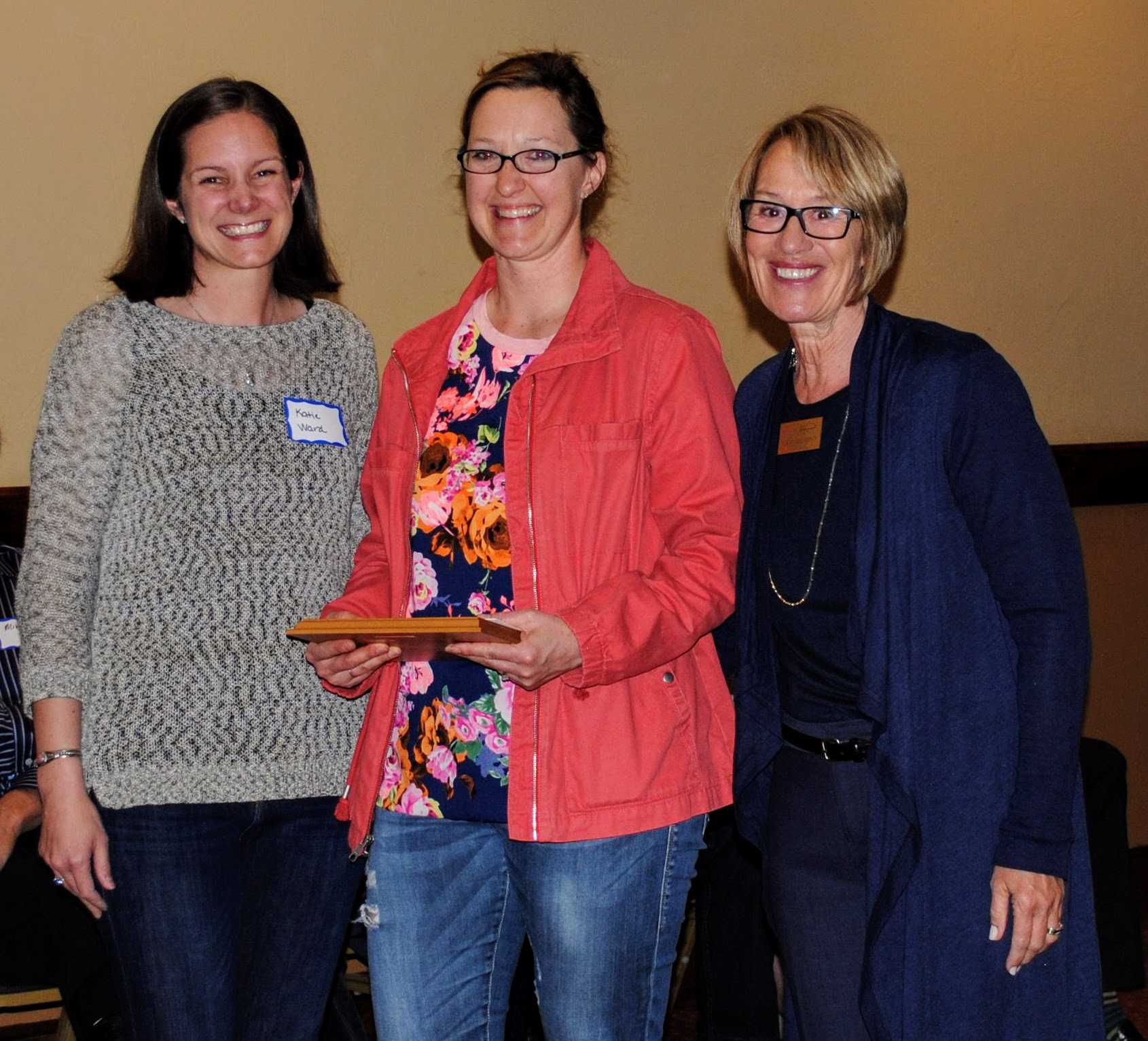Board Member Linda Maetzold presents the Doris Schumm Community Spirit Award to Katie Ward and Gloria Nelson, representing Project Whitefish Kids.